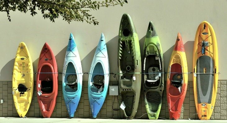 Kayaks resting against a wall