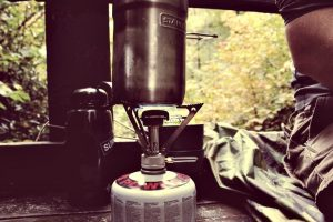 Backpacking stove on a wooden counter
