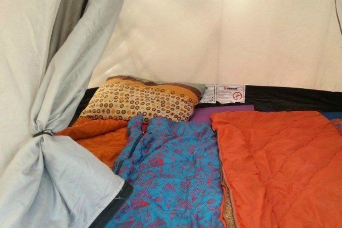 inside of a tent with sleeping bag and pillow