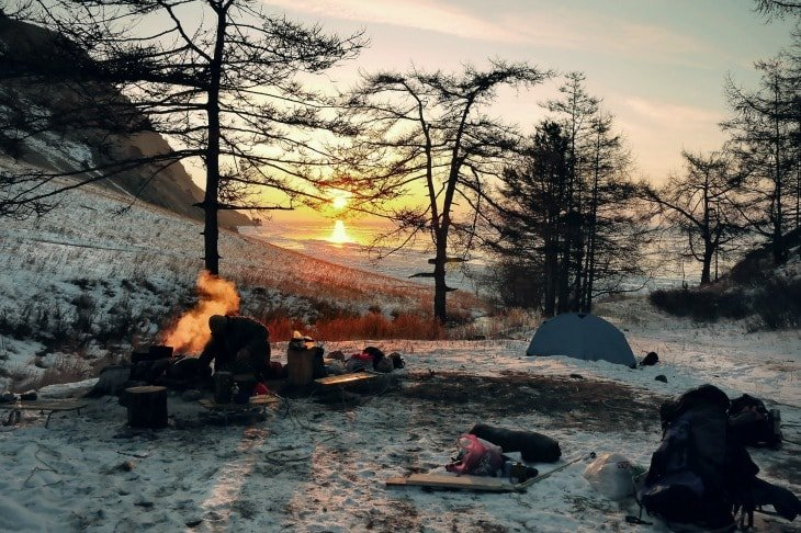 Winter camping ground with the sun setting