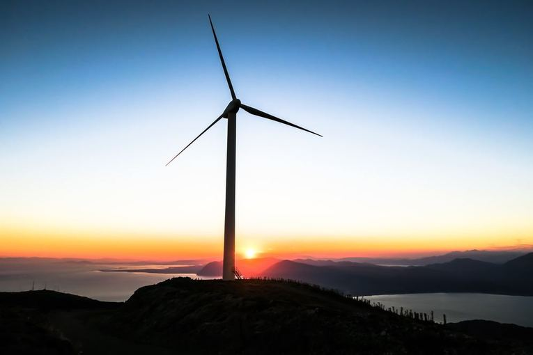 A wind turbine during sunset