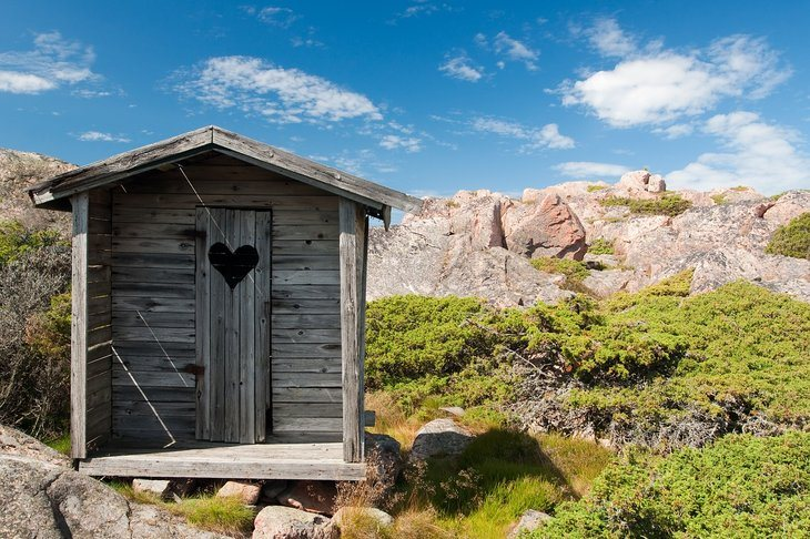 An old wooden outhouse in the mountains