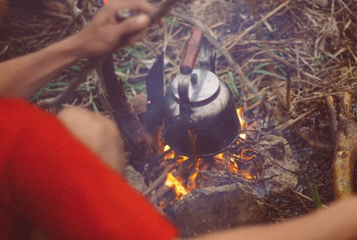 A pot resting over an open fire