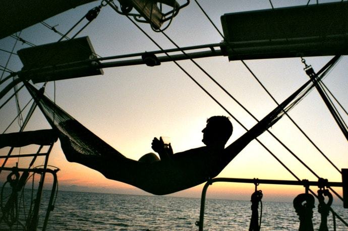 A hammock hanging on a sailboat