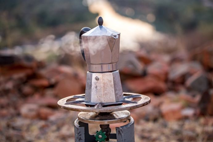 Pot of coffee boiling on a backpacking stove