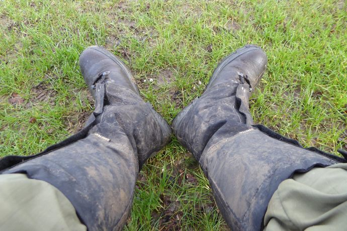 Two boots with gaiters up to the knee