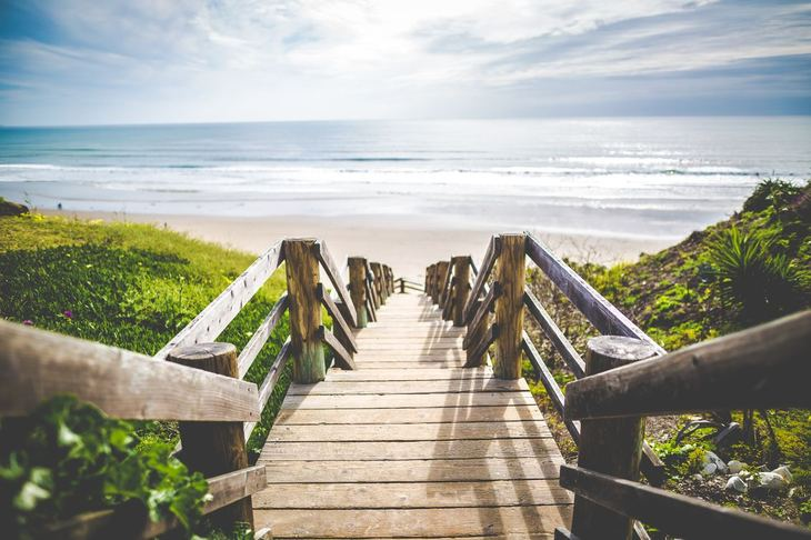 A wood staircase leading down to the beach