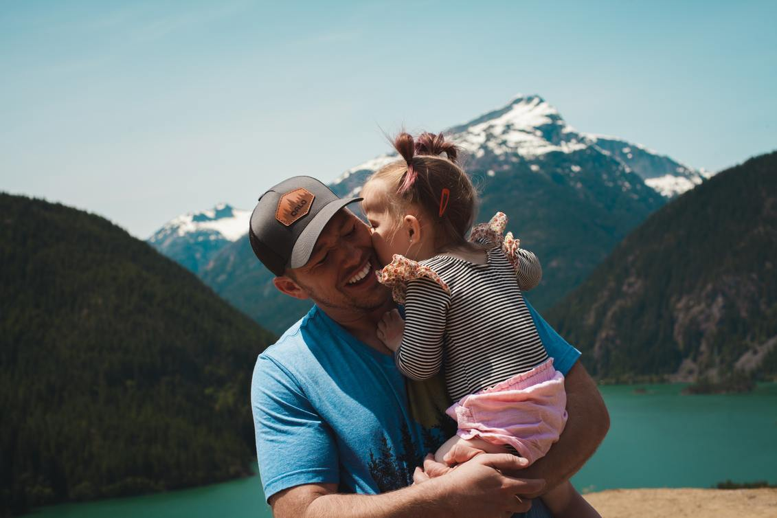 Man hiking with his young daughter