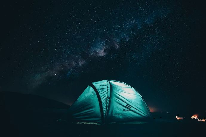 A dome tent sitting under the stars