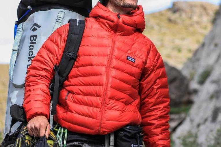 A person in a red puffy coat outdoors