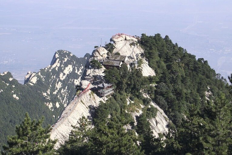 High mountain peak with a building on top