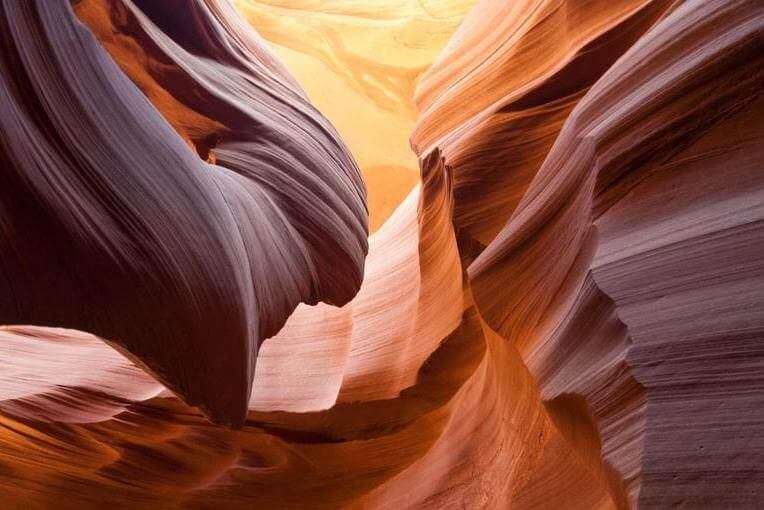 A red and orange canyon with smooth lines.