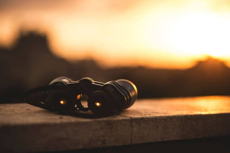 A pair of binoculars sitting on a ledge.
