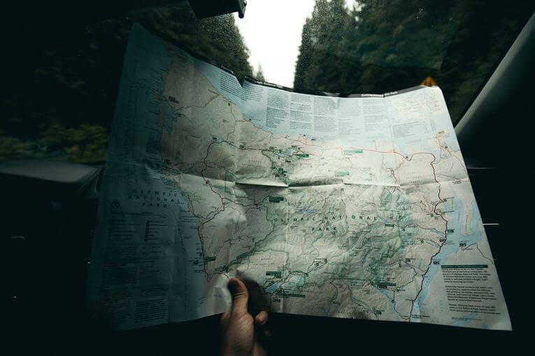 Person holding a map.