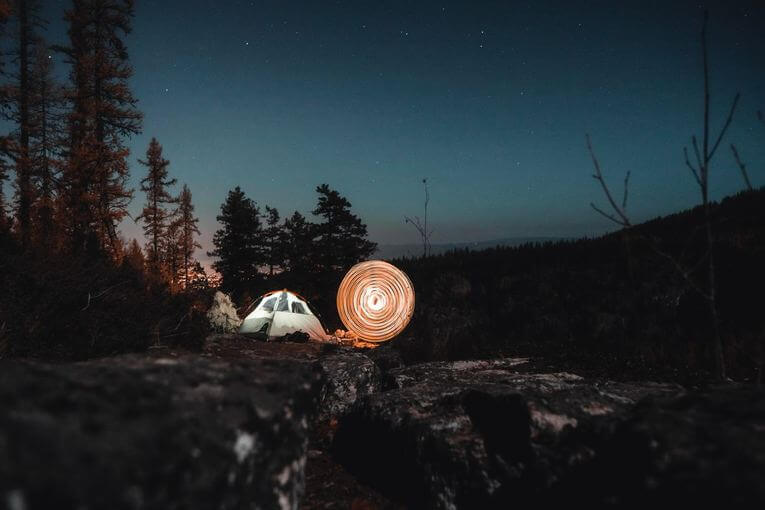 Tent on a cliff at night