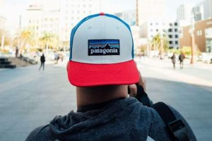 Man standing with a backwards Patagonia hat on