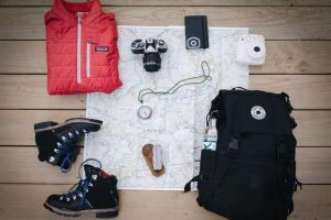 Backpacking gear on a white table.